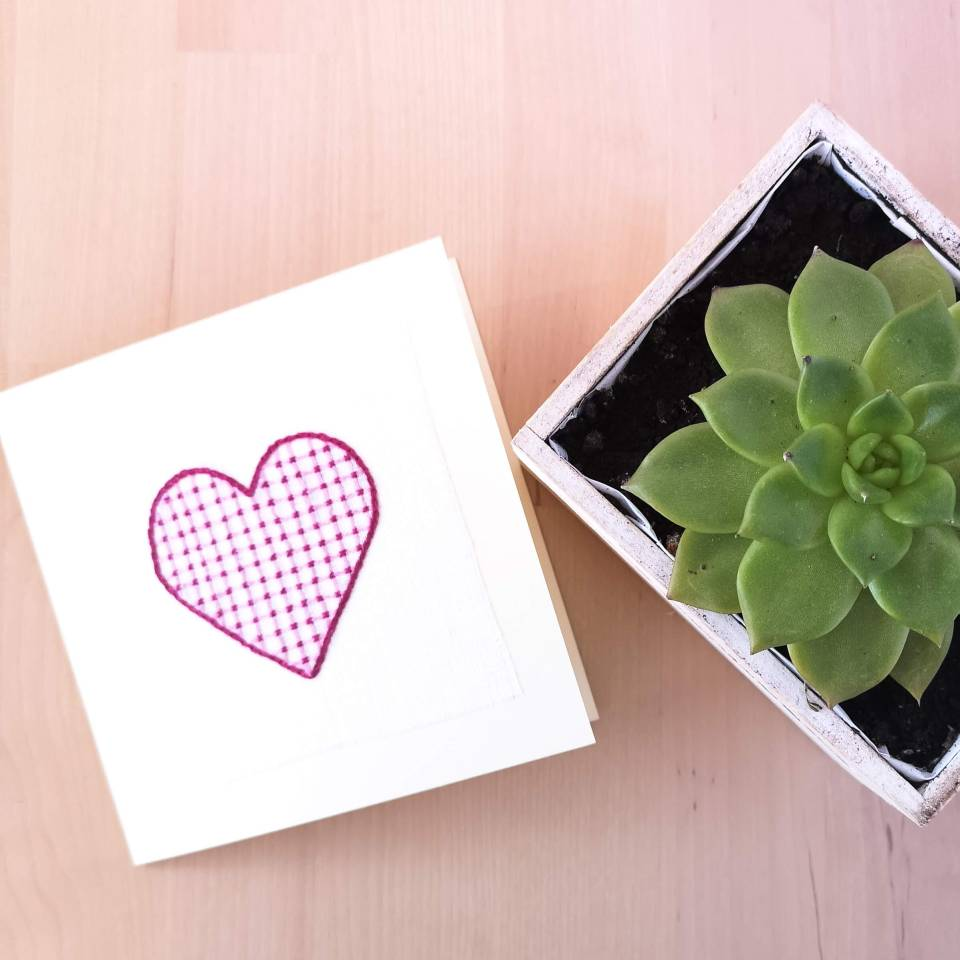 Greeting card with pink embroidered heart