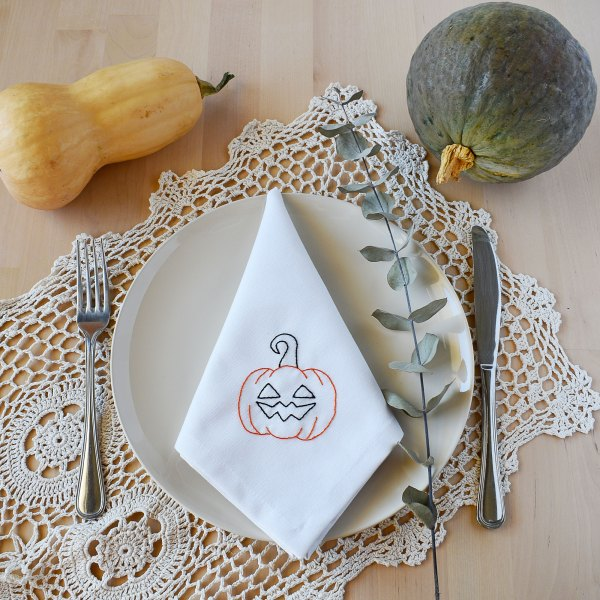 Embroidered fabric napkin with pumpkin design for halloween