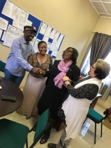 African Tourism Board breaks barriers: SA Deputy Tourism Minister and students in Pretoria smiling