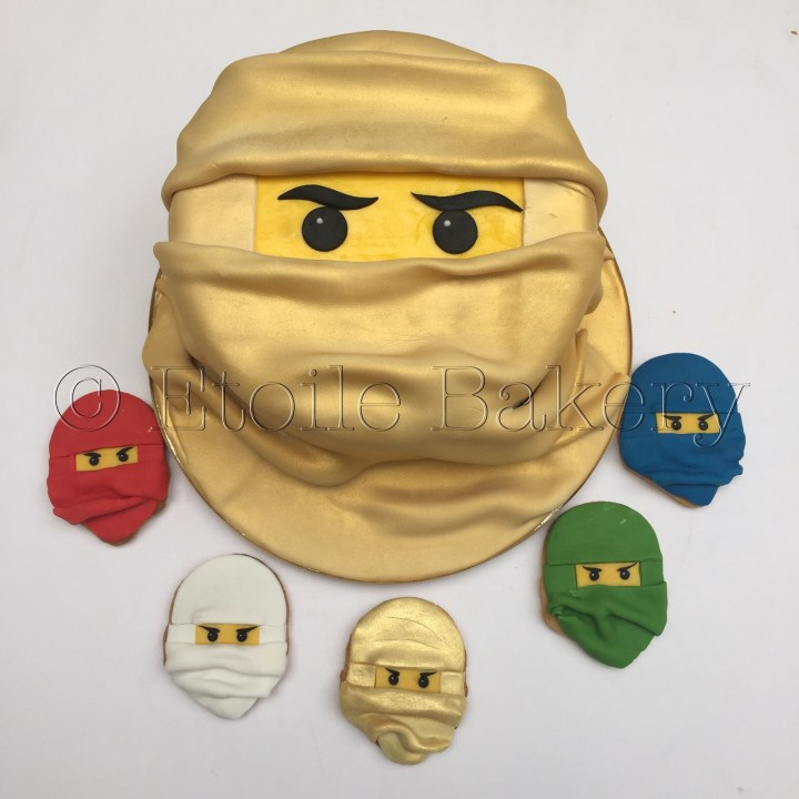 Gold ninjago birthday cake and biscuits