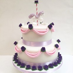 Drape and carousel horse cake