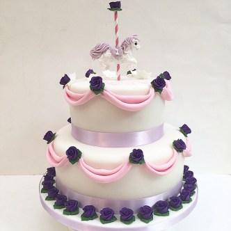 Drape and carousel horse cake