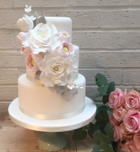Wedding Cake with Large Bouquet of Flowers
