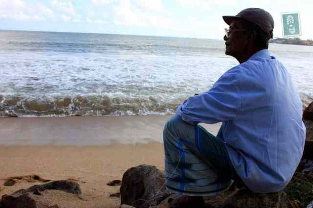 Man is sitting on the beach, Galle