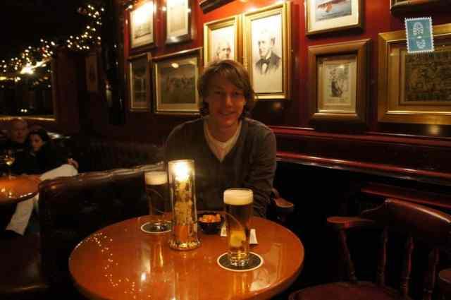 A Dutch guy sitting in a bar drinking a beer