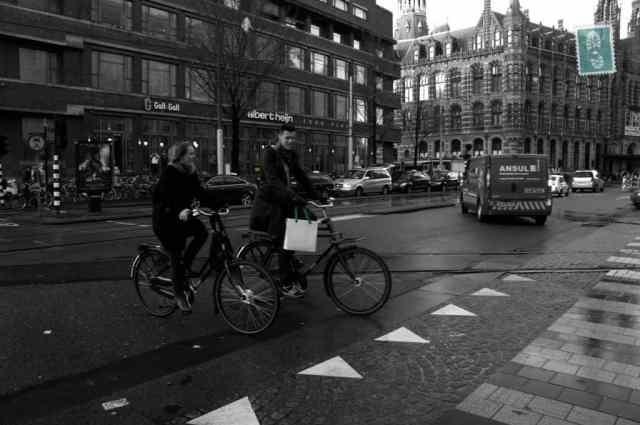 Dutch people riding a bike