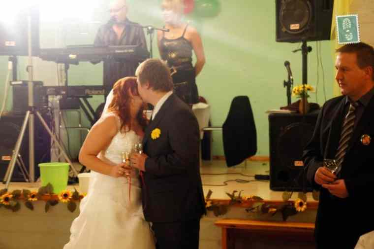 First kiss of a just married couple