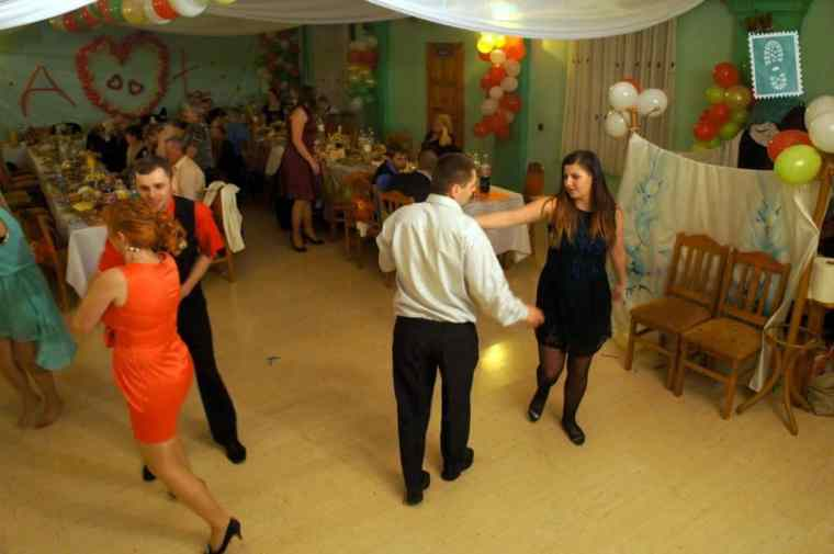 People are dancing at a wedding