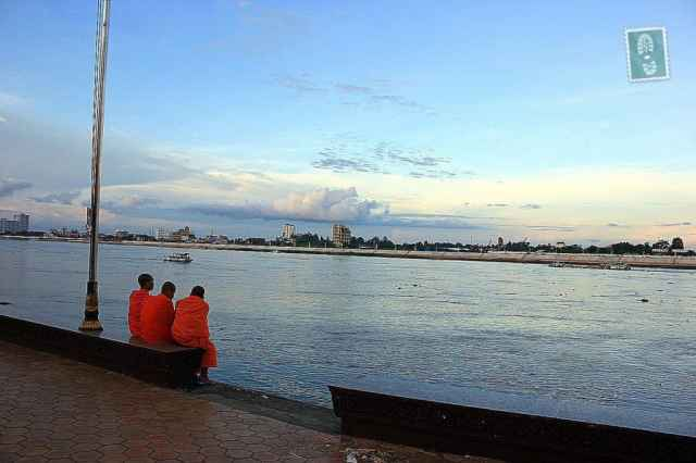 3 Cambodian monks sitting at the river