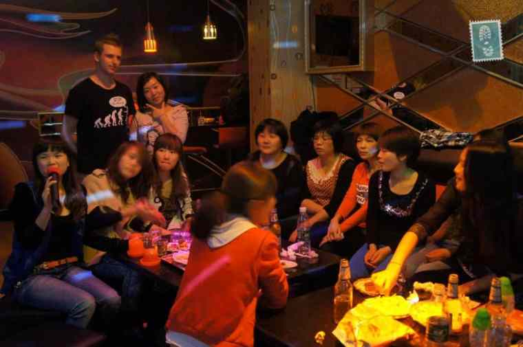Chinese people in KTV singing and eating