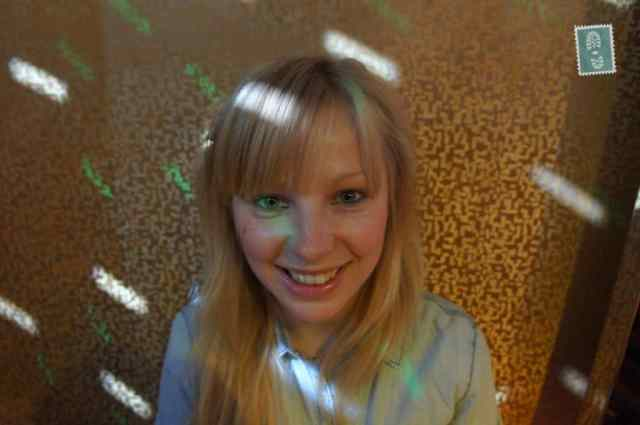 A blond girl smiling in KTV