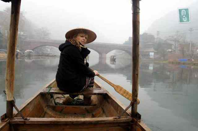A girl on a boat in Fenghuang