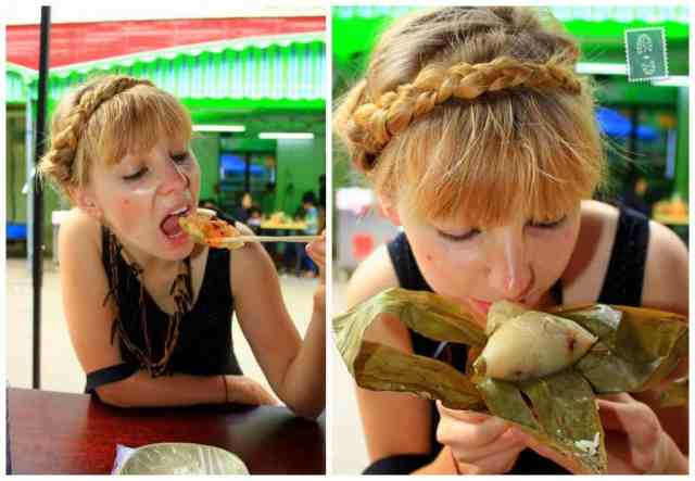 A girl is eating jiaozi and smelling sticky rice