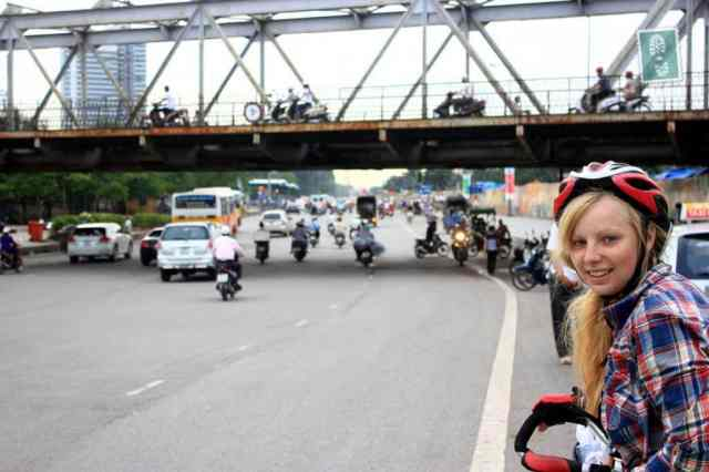 Traffic jam in Hanoi a girl on a bike