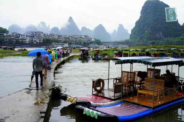 Just about to start our boat ride across Yangshuo River. Everyone was equipped with umbrellas