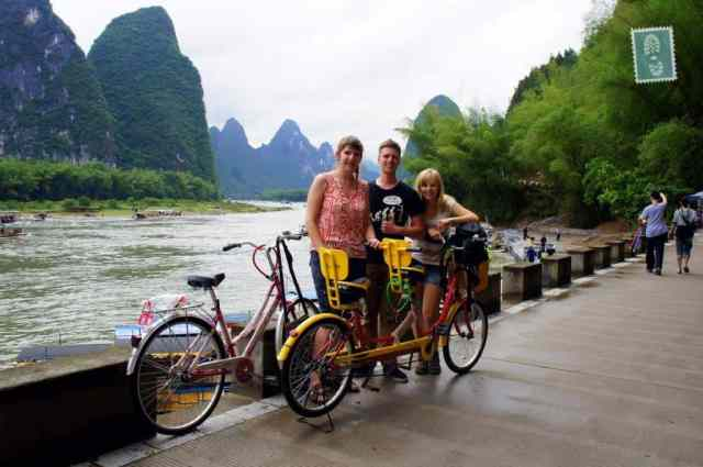 3 people are cycling in Xing Ping