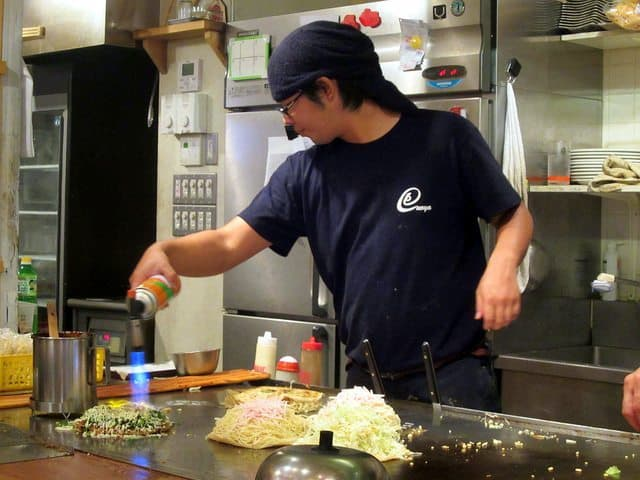 The making of okonomiyaki in Hiroshima, Japan