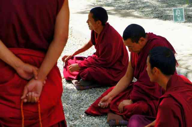 4 Tibetan monks praying