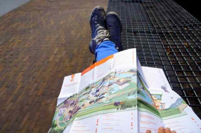 A girl is checking a map of Madurodam