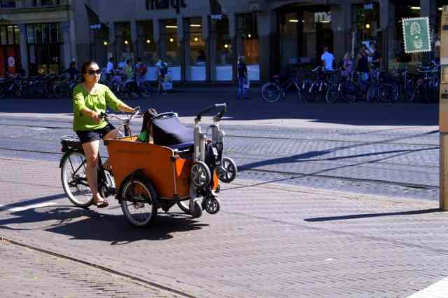 A woman riding a bike in Hague