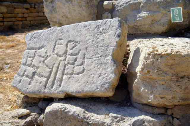 Ancient writing on the stone, the Palace of Knossos
