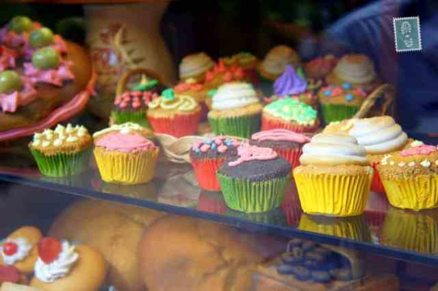 Lovely colorful cupcakes in one of local shops