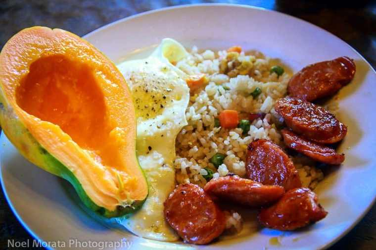 Hawaiian breakfast : mango, avocado, rice, egg and sausages