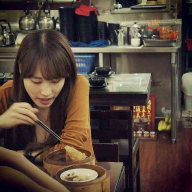 A girl is eating dim sum in Hong Kong Dim Sum Square Restaurant