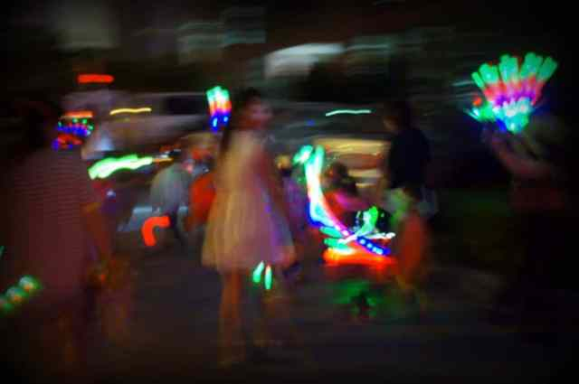 Chinese kids and teachers are walking at night Halloween