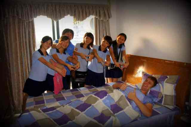Chinese girls are visiting a boy