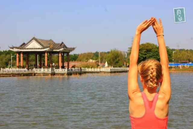 Morning yoga stretch at Songshan Lake, Dalang, Dongguan.