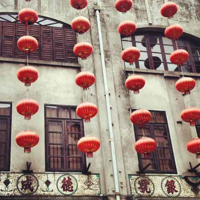 Chinese lanterns hanging on Macau buildings.