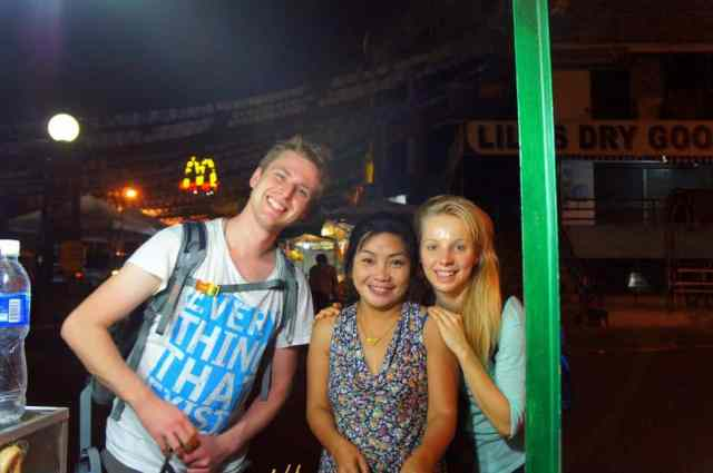 Filipino woman with two foreigners