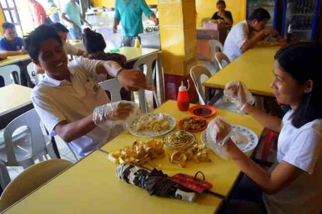 Locals enjoying their lunch in Manila