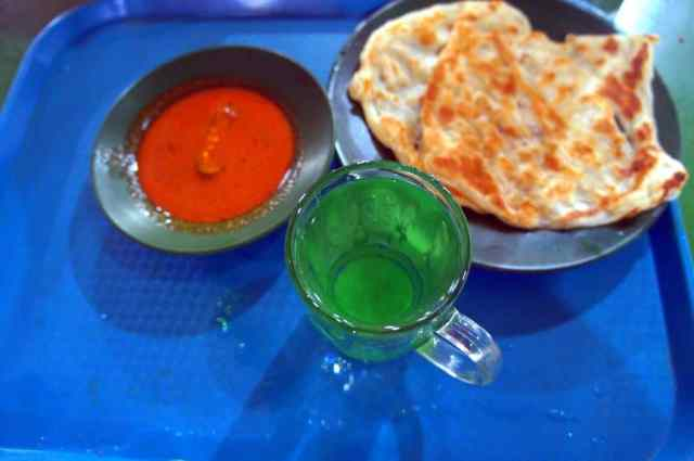 Typical Indian dish - Indian pancakes with curry sauce