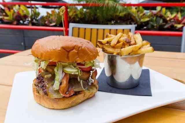 Smoke house burger  ($15) – classic cheese burger, smoked cheddar bacon, black & tan onion ring.