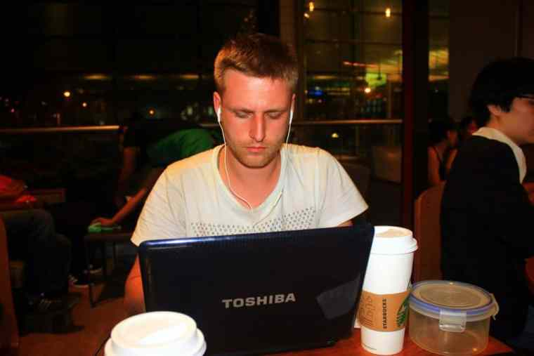 A boy working with his laptop