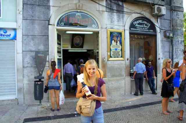 a girl with a bottle of cherry liquer in Lisbon