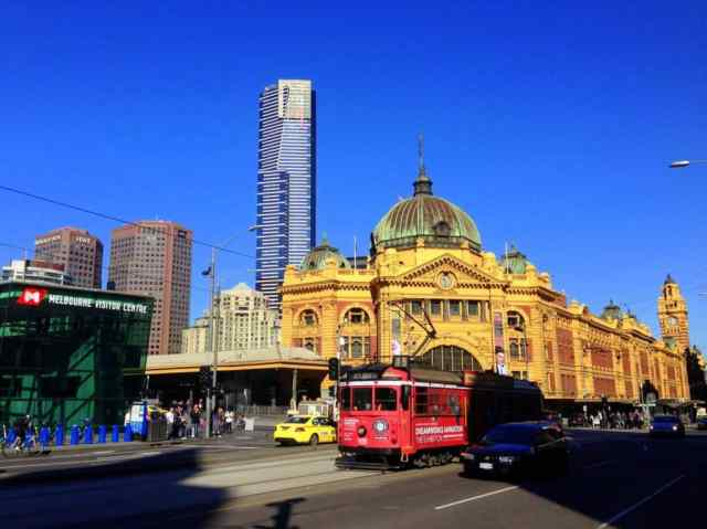 Eureka Tower dwarfs Flinders Street Station and the free City Circle tram