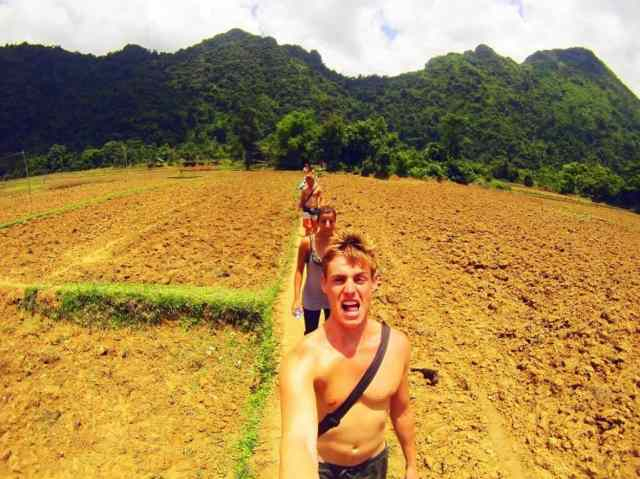 Walking-through-Rice-Paddies,-Vang-Vieng