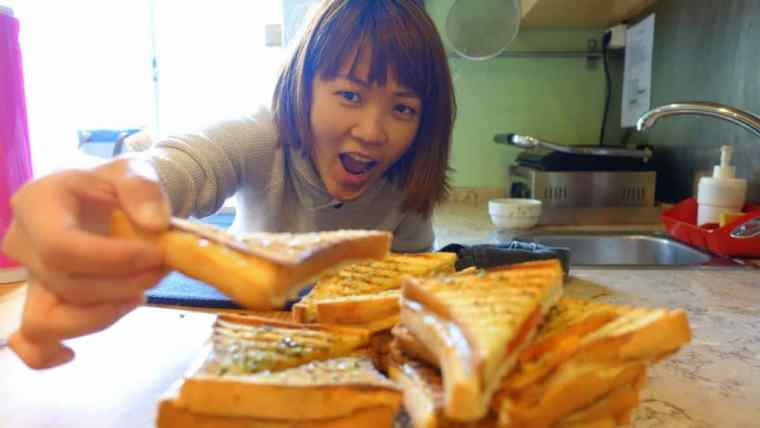 Lydia enjoying free breakfast at Goodmorning hostel