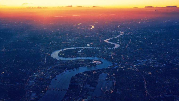 Helicopter view of the Thames, London at sunrise.
