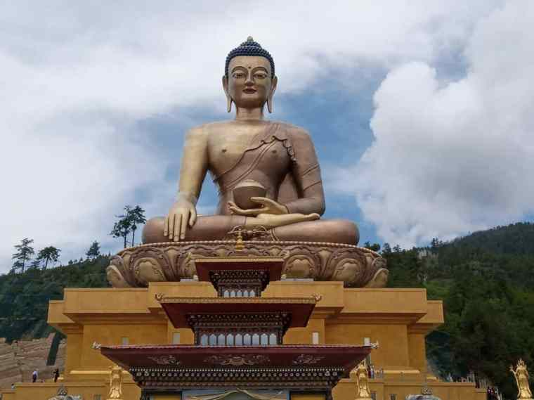 The Buddha Dordenma - a gigantic golden Buddha statue in the Bhutan mountains.