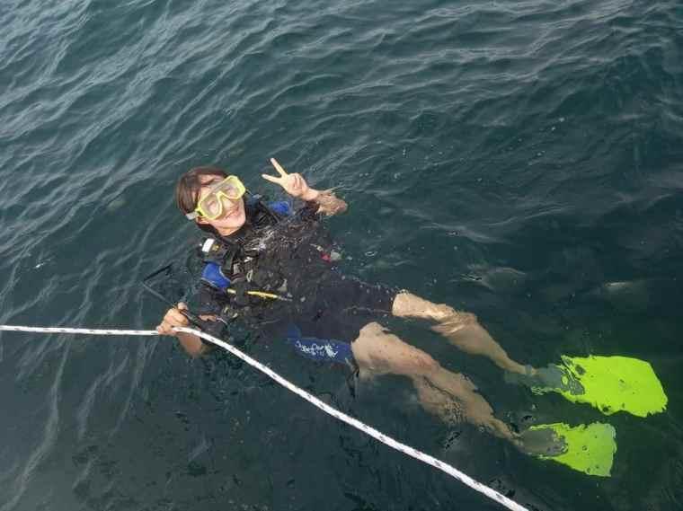 Lydia prepares to scuba dive
