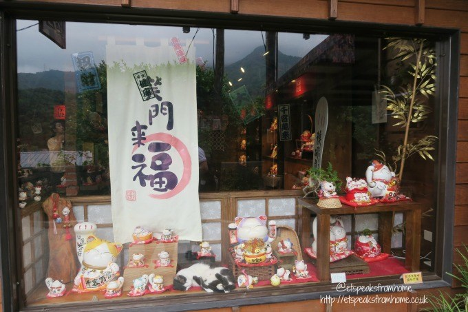 houtong cat village cat in shop front window