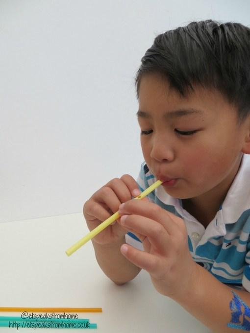 playing drinking straw
