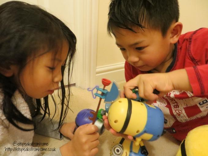 minion toy playing