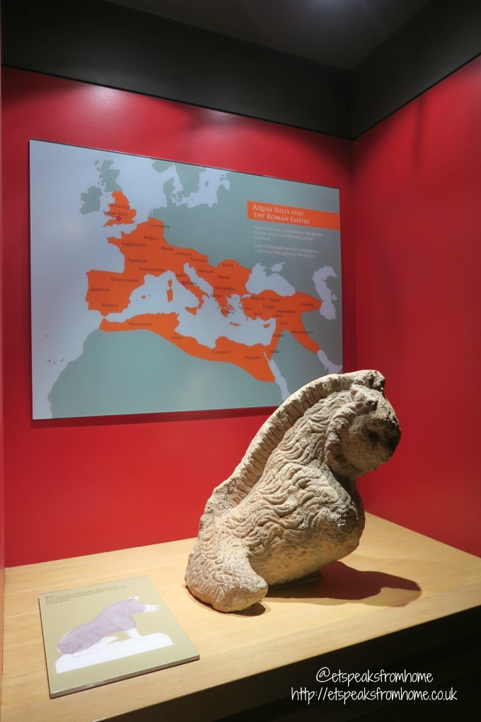 roman baths review statue