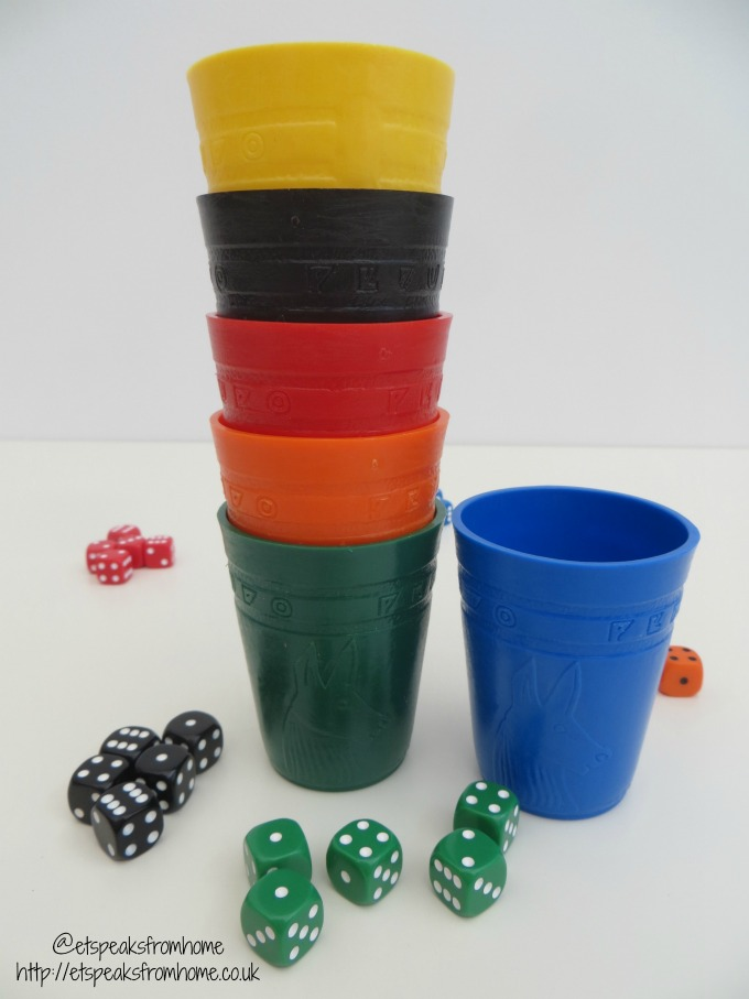 perudo game cups and dice