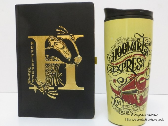 Harry Potter and Wizarding World travel mug and book
